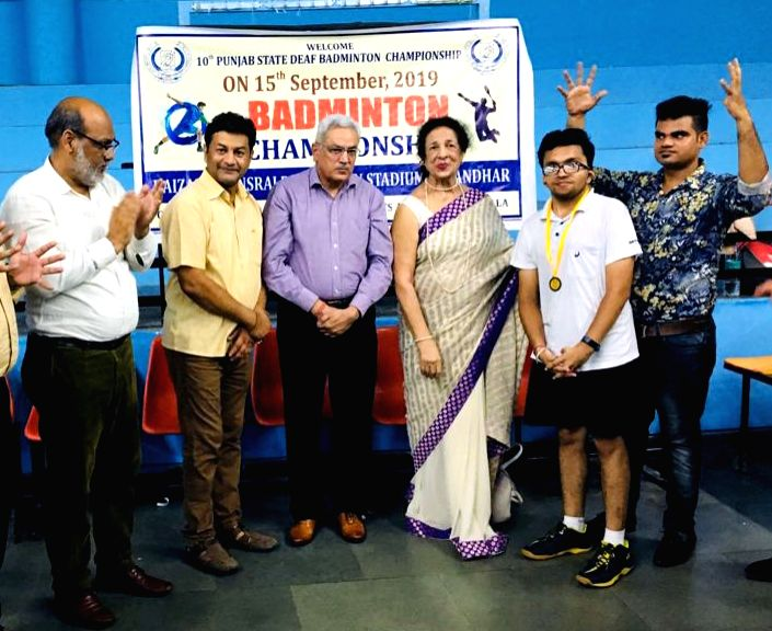Yashveer Goyal, a hearing and speech impaired youth of Bathinda, being awarded at a prize distribution ceremony after the completion of 10th Punjab State Deaf Badminton Championship, in Punjab's ...
