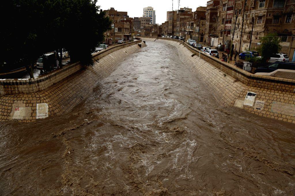 YEMEN, Aug. 10, 2019 - Photo taken on Aug. 10, 2019 shows a flooding river after the heavy rain in Sanaa, Yemen. Heavy rain hit Sanaa on Saturday.