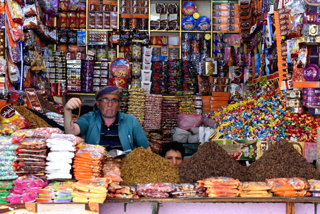 YEMEN, June 2, 2019 - An owner of a food store waits for customers at a public market in Aden city, Yemen, June 2, 2019.