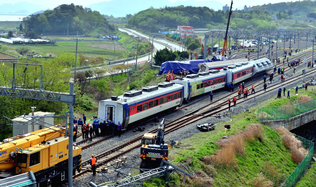 YEOSU, April 22, 2016 - Rescuers work at the train derailment accident site in Yeosu, South Korea, on April 22, 2016. One locomotive engineer has been dead, with eight passengers injured, in a South ...