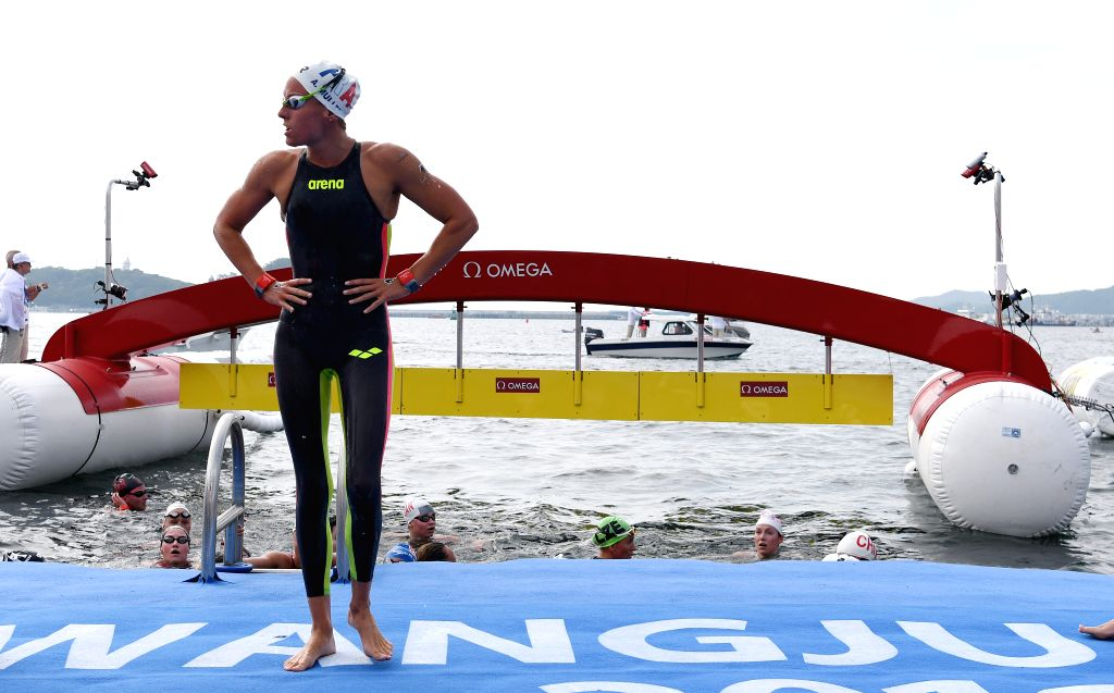 YEOSU, July 17, 2019 - Aurelie Muller of France (front) reacts after the women's 5km open water swimming at the 2019 FINA World Championships in Yeosu, South Korea, July 17, 2019.