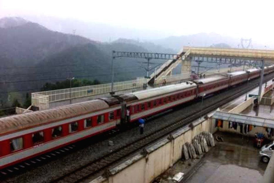 Photo taken with a mobile phone shows a passenger train stopping at the Changyang Railway Station in Changyang Tu Autonomous County of Yichang City, central China's