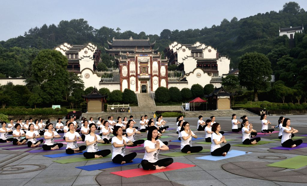 YICHANG, June 20, 2017 - Yoga lovers practice yoga in the morning at a scenic spot in Zigui County, central China's Hubei Province, June 20, 2017.