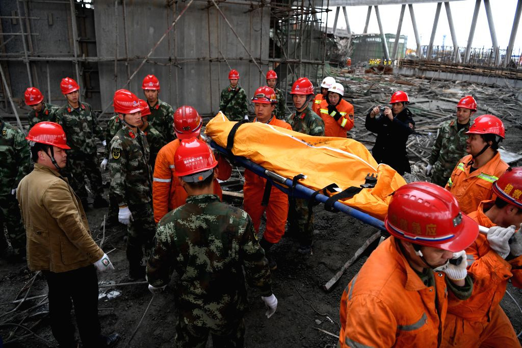 YICHUN, Nov. 24, 2016 - Rescuers carry out the body of a victim at the accident site at the Fengcheng power plant in Yichun City, east China's Jiangxi Province, Nov. 24, 2016. Sixty-seven people have ...