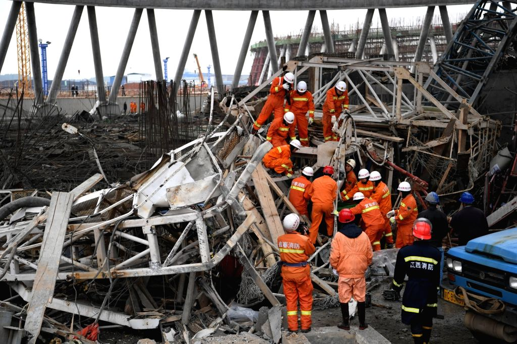 YICHUN, Nov. 24, 2016 - Rescuers work at the accident site at the Fengcheng power plant in east China's Jiangxi Province, Nov. 24, 2016. More than 40 people have been confirmed dead after the ...