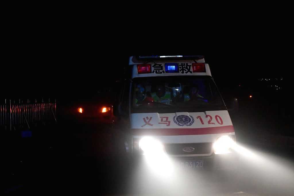 YIMA, July 20, 2019 (Xinhua) -- An ambulance is on standby at the explosion site of a gas factory in Yima City, central China's Henan Province, July 20, 2019. At least 10 people have been killed, 19 severely injured and five others are missing after