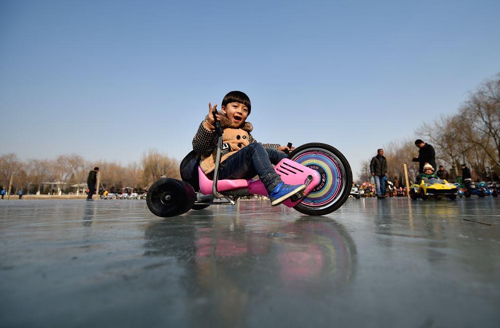 A boy rides a bike on ice at the Zhongshan Park in Yinchuan, capital city of northwest China's Ningxia Hui Autonomous Region, Jan. 25, 2015.    .