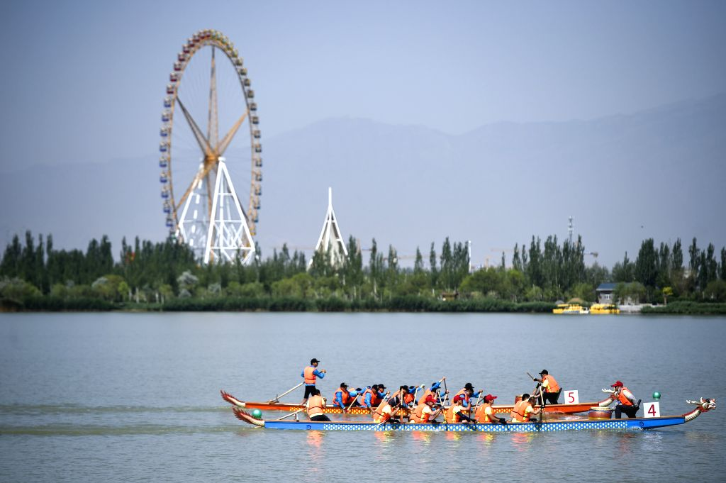 YINCHUAN, June 5, 2019 - People participate in a dragon boat competition on Yuehai River in Yinchuan, capital of northwest China's Ningxia Hui Autonomous Region, June 5, 2019.