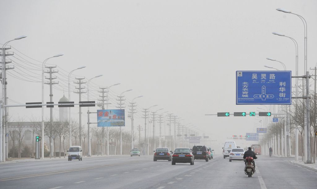 Vehicles run in dust and sand in Wuzhong City, northwest China's Ningxia Hui Autonomous Region, March 2, 2015. The region's weather observatory issued a blue alert ...