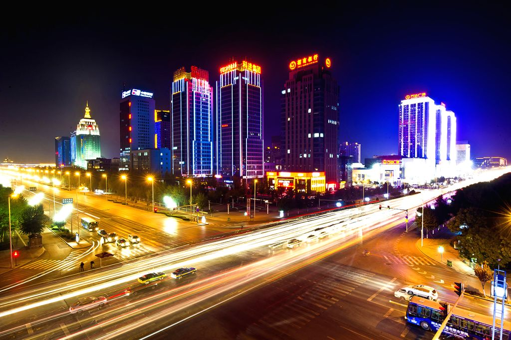 Photo taken on Oct. 31, 2012 shows the night scenery of CBD of Jinfeng District in Yinchuan, northwest China's Ningxia Hui Autonomous Region. The local government .
