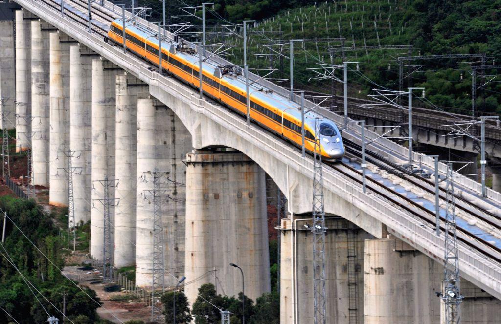A bullet train runs for test in the Yiwu section of  Hangzhou-Changsha high-speed railway in Yiwu City, east China's Zhejiang Province, July 31, 2014. The 933-kilometer