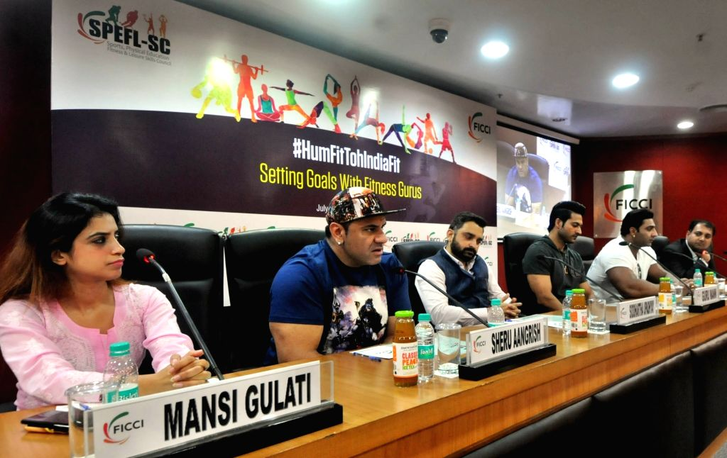 Yoga expert Mansi Gulati, Nutritionist and fitness professional Guru Mann, bodybuilders Sheru Aangrish and Varinder Singh Ghuman during awareness programme '#HumFitTohIndiaFit', in New ... - Varinder Singh Ghuman