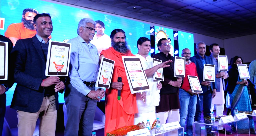 Yoga guru and Patanjali founder Baba Ramdev, CEO Balkrishna and other dignitaries during a press conference in New Delhi on Jan 16, 2018. Baba Ramdev on Tuesday launched its e-commerce ...