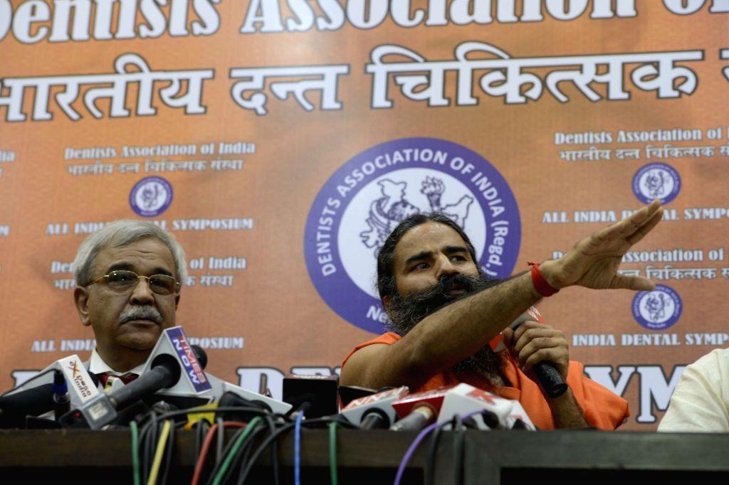 Yoga guru Baba Ramdev addresses a press conference in New Delhi on Aug 13, 2016.