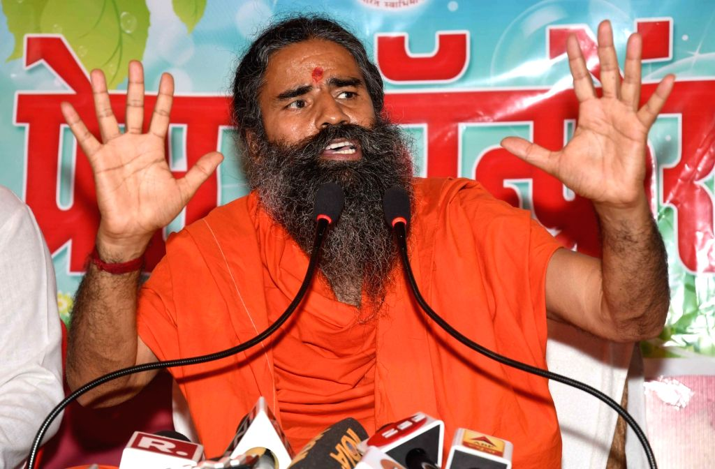 Yoga Guru Baba Ramdev addresses a press conference in Patna, on April 26, 2019.