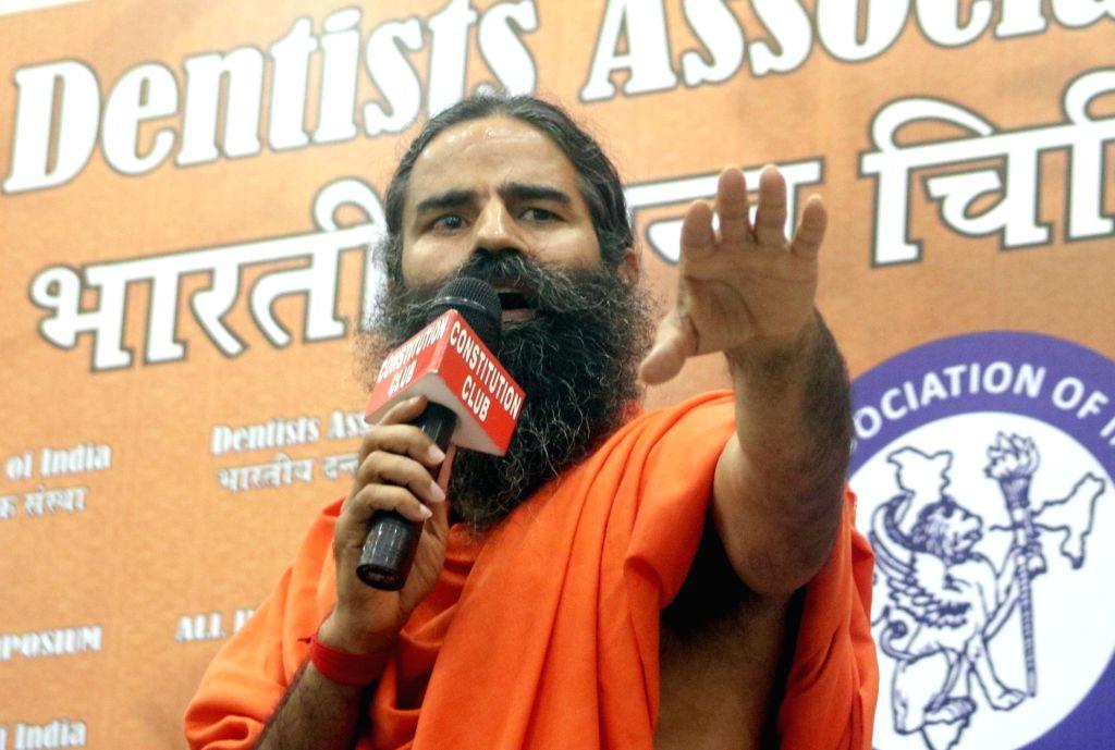 Yoga guru Baba Ramdev addressing a press conference regarding acceptance of certificate of accreditation of DANT KANTI in New Delhi on Aug 13, 2016.