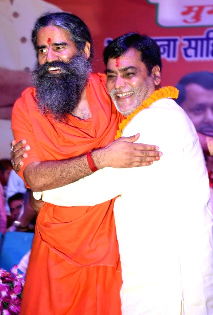 Yoga Guru Baba Ramdev and BJP's Lok Sabha candidate from Pataliputra, Ram Kripal Yadav during a public rally, in Patna, on April 26, 2019. - Kripal Yadav