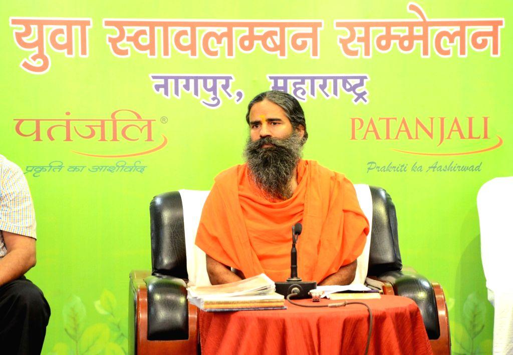 """Yoga Guru Baba Ramdev during """"Yuva Swavalamban Sammelan"""", in Nagpur on July 21, 2018."""