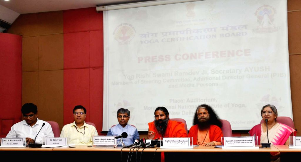 Yoga Guru Baba Ramdev, Ministry of AYUSH Secretary Vaidya Rajesh Kotecha and other dignitaries at a press conference to brief about the development of the Scheme of Certification of Yoga ...