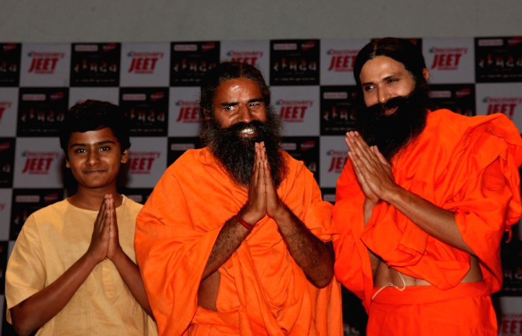 Yoga Guru Baba Ramdev with actor Kranti Prakash Jha and child artiste Naman Jain during a press conference on the launch of a biopic series 'Swami Ramdev: Ek Sangharsh' based on his life; ... - Kranti Prakash Jha and Naman Jain