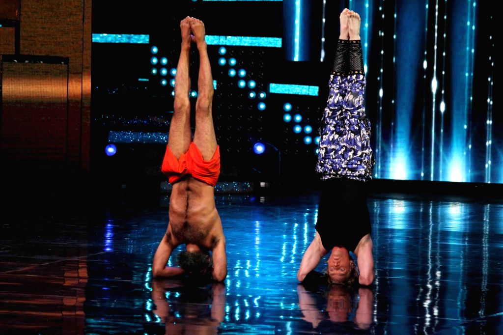 Yoga guru Baba Ramdev with contestant Brent Goble on the sets of Star Plus TV show Nach Baliye Season 8 in Mumbai on May 16, 2017.