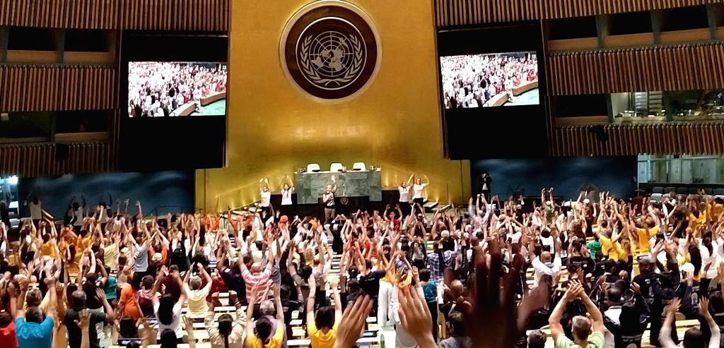 """Yoga Guru Kevin Tobar of the Bhakti Centre leads a session of """"office yoga"""" at the United Nations General Assembly hall after rains forced the International Day of Yoga celebrations to move indoors. (Photo: Arul Louis/IANS)"""