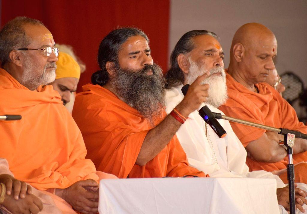 """Yoga guru Ramdev addresses """"Holi Mahotsav"""" in Mathura, on March 7, 2019."""