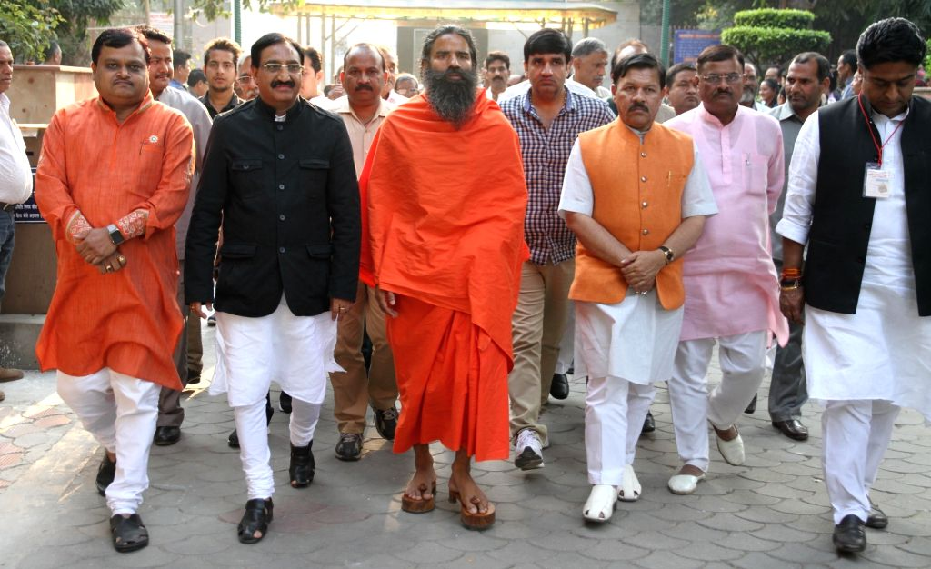 Yoga Guru Ramdev at the cremation of late VHP leader Ashok Singhal in New Delhi on Nov 18, 2015.