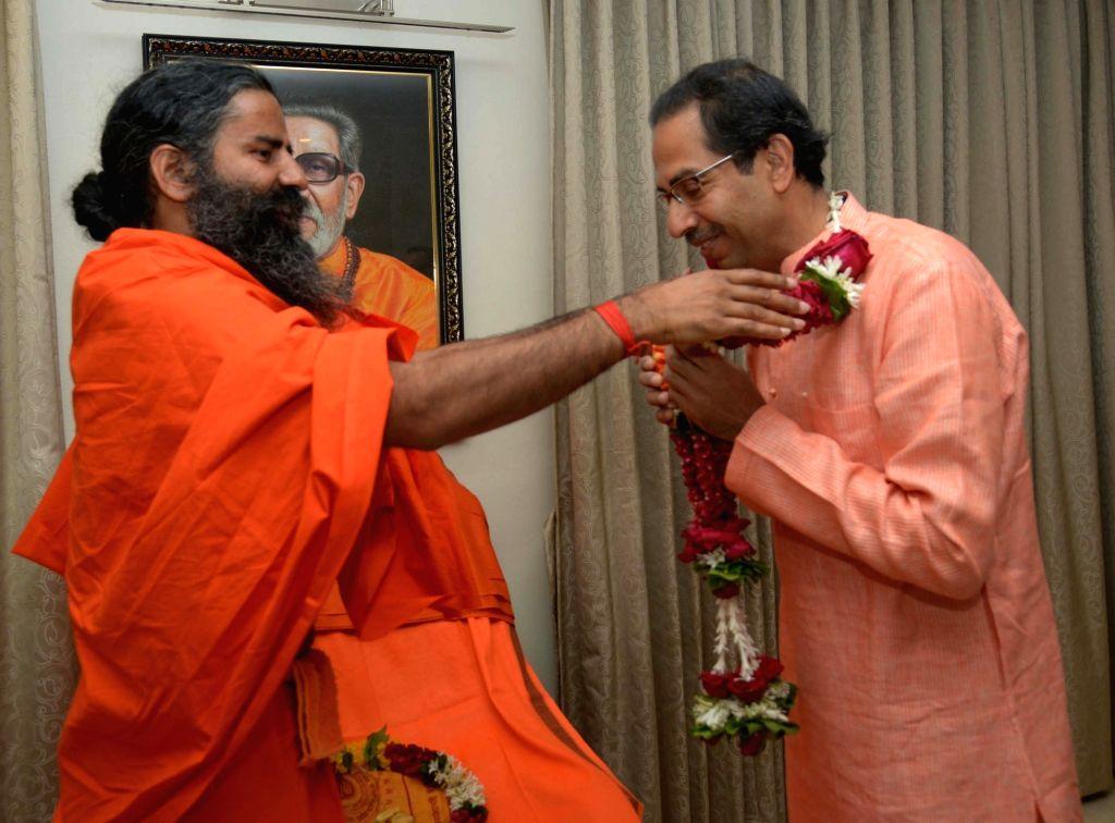 Yoga Guru Ramdev calls on the Shivsena Chief Uddhav Thackeray at Matoshree, Bandra in Mumbai, on Jan 16, 2016.