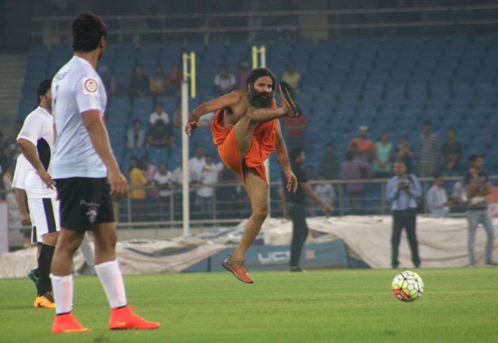 Yoga Guru Ramdev in action during a football match between Bollywood Celebrities and Members of Parliament at Jwahar Lal Nehru Stadium, in New Delhi on July 24, 2016.