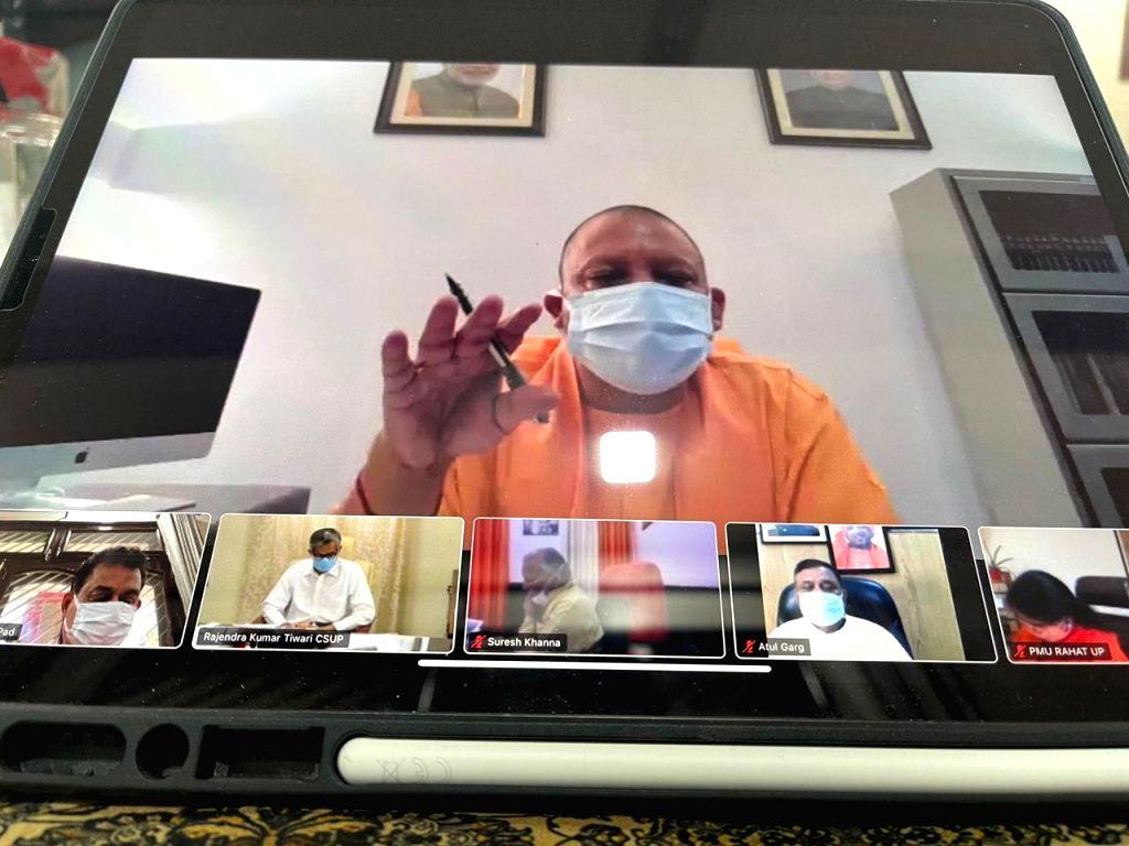 Yogi in virtual meeting despite being Covid positive.