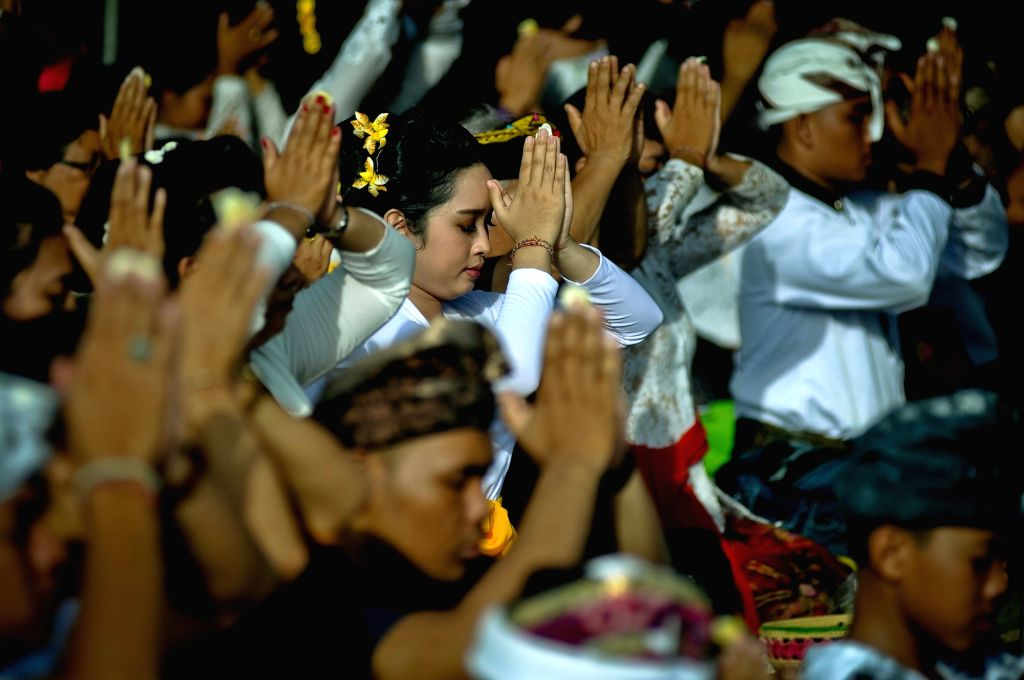 YOGYAKARTA, March 3, 2019 - Indonesian Hindu devotees participate in a Melasti ceremony in Yogyakarta, Indonesia, March 3, 2019. Indonesian Hindus hold the Melasti ceremony to clean their souls ...