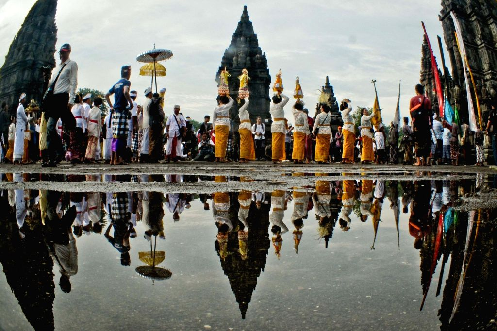 YOGYAKARTA, March 6, 2019 - Indonesian Hindu devotees participate in a ceremony ahead of the Nyepi Day at Prambanan Temple in Yogyakarta, Indonesia, on March 6, 2019. Nyepi marks the New Year day of ...
