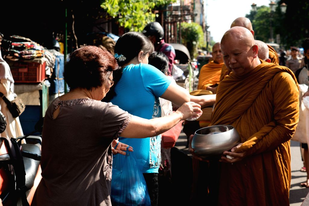 YOGYAKARTA, May 9, 2017 - Buddhist monks collect alms from followers ahead of the Vesak Day in Malioboro, Yogyakarta of Indonesia, on May 9, 2017. Indonesian Buddhists and followers celebrate the ...