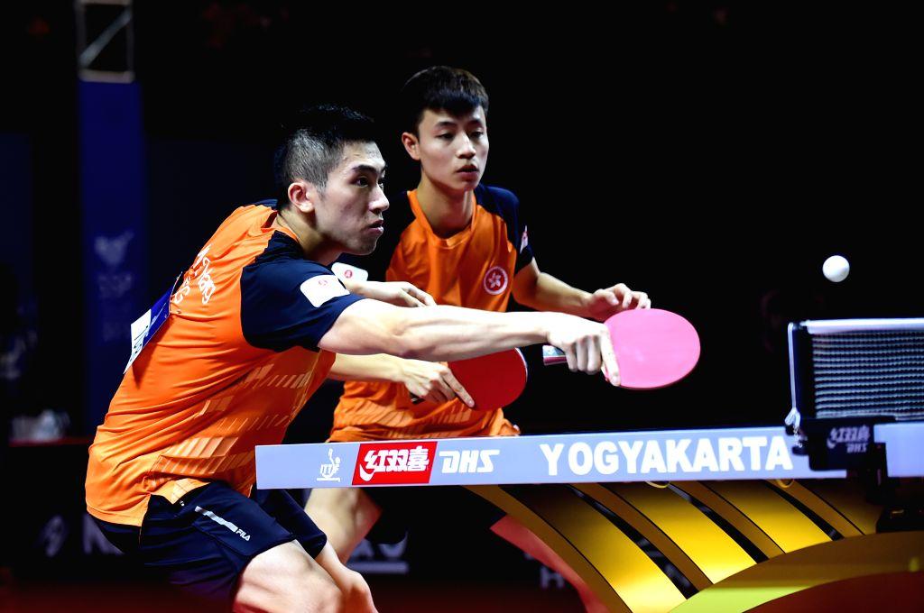YOGYAKARTA, Sept. 21, 2019 - Lam Siu Hang (L)/Ng Pak Nam of Hong Kong of China compete during the men's doubles semifinal match between Liang Jingkun/Lin Gaoyuan of China and Lam Siu Hang/Ng Pak Nam ...