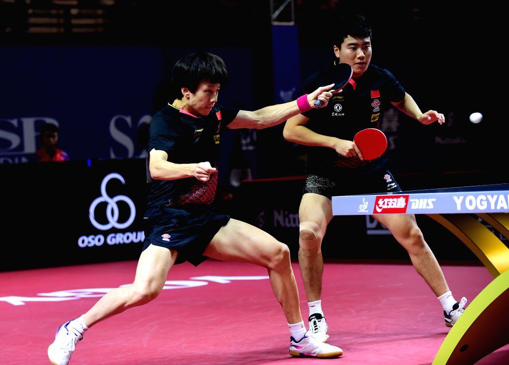 YOGYAKARTA, Sept. 21, 2019 - Liang Jingkun/Lin Gaoyuan (L) of China compete during the men's doubles semifinal match between Liang Jingkun/Lin Gaoyuan of China and Lam Siu Hang/Ng Pak Nam of Hong ...