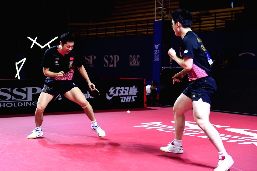 YOGYAKARTA, Sept. 21, 2019 - Xu Xin/Fan Zhendong (R) of China react during the men's doubles semifinal match between Xu Xin/Fan Zhendong of China and Yoshimura Maharu/Togami Shunsuke of Japan at the ...