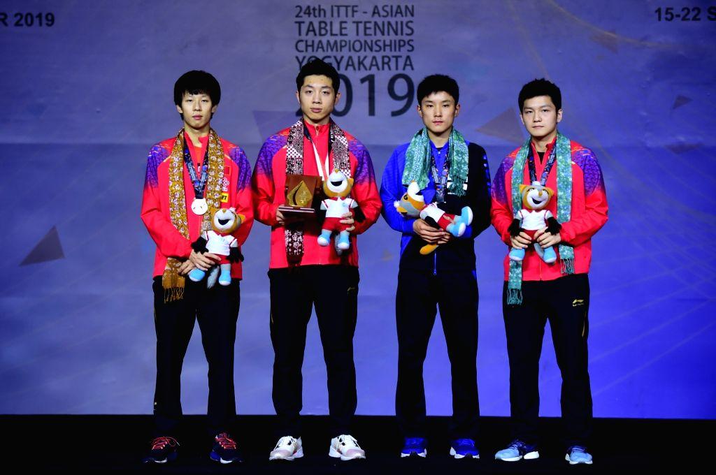 YOGYAKARTA, Sept. 22, 2019 - Gold medalist Xu Xin (2nd L) of China, silver medalist Lin Gaoyuan (1st L) of China and bronze medalists Harimoto Tomokazu (2nd R) of Japan and Fan Zhendong of China pose ...