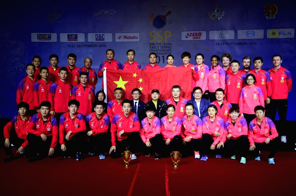 YOGYAKARTA, Sept. 22, 2019 - Team China pose for photos after the 2019 Asian Table Tennis Championship in Yogyakarta, Indonesia, Sept. 22, 2019.