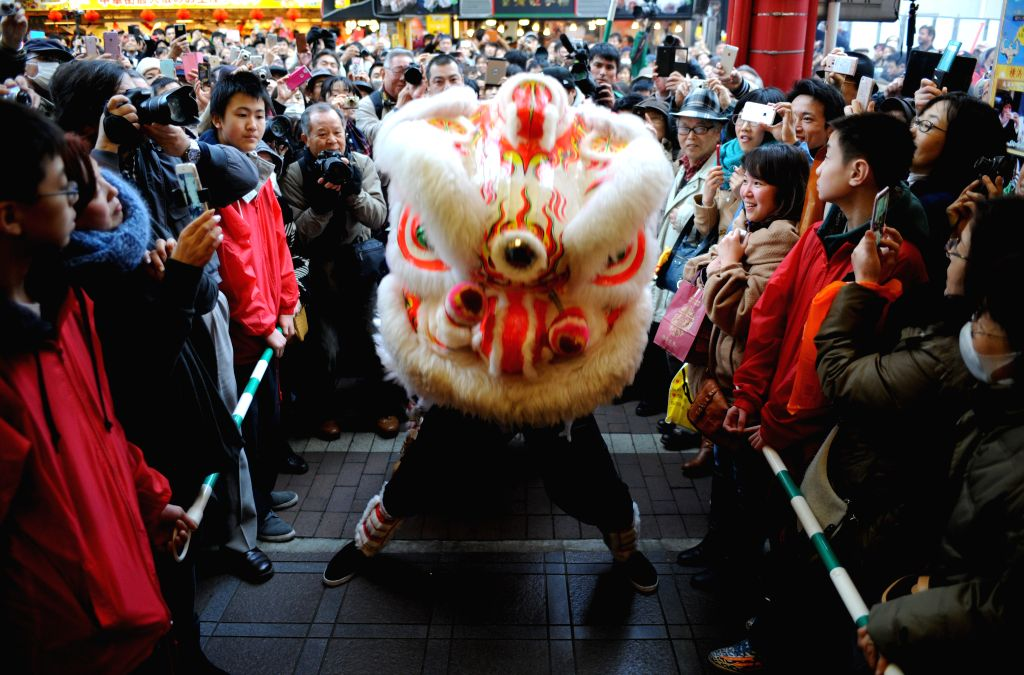 A lion dance is performed to celebrate the Chinese lunar new year at Yokohama China Town in Kanagawa prefecture, near Tokyo, Japan, Feb. 19, 2015. ...