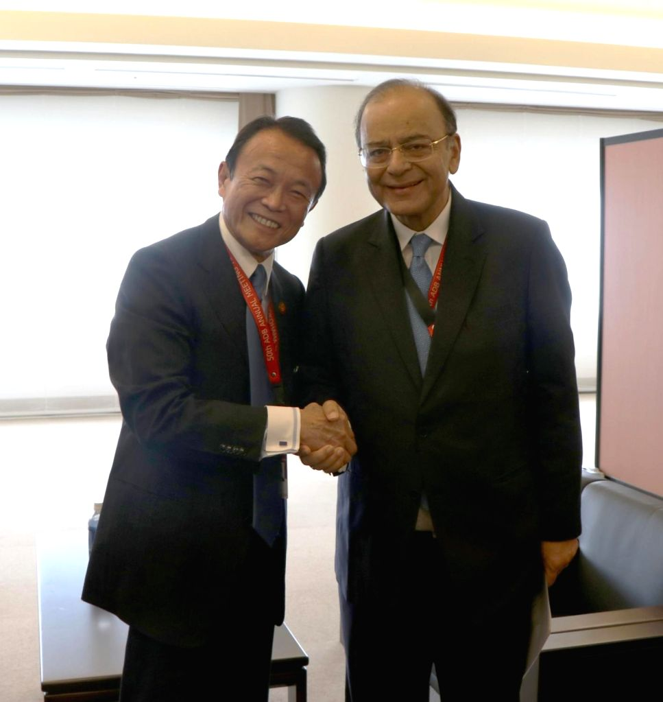 Yokohama (Japan):  Union Finance Minister Arun Jaitley meets Japanese Finance Minister Taro Aso, on the sidelines of the annual Asian Development Bank Board of Governors' meeting, in Yokohama, ... - Arun Jaitley