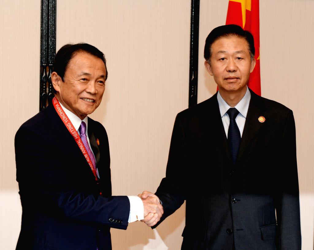 YOKOHAMA, May 6, 2017 - China's Finance Minister Xiao Jie (R) shakes hands with his Japanese counterpart Taro Aso during the sixth China-Japan bilateral finance dialogue in Yokohama, Japan, May 6, ... - Xiao Jie