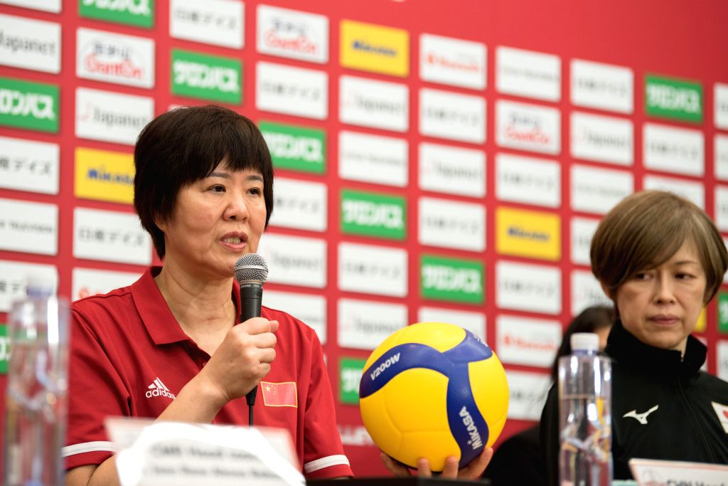 YOKOHAMA, Sept. 13, 2019 - Lang Ping (L), head coach of China, speaks at the pre-match press conference at the 2019 Volleyball Women's World Cup in Yokohama, Japan, Sept. 13, 2019.