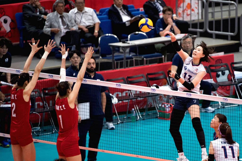 YOKOHAMA, Sept. 14, 2019 - Park Jeongah (R, top) of South Korea spikes the ball during the Round Robin match between China and South Korea at 2019 Volleyball Women's World Cup in Yokohama, Japan, ...