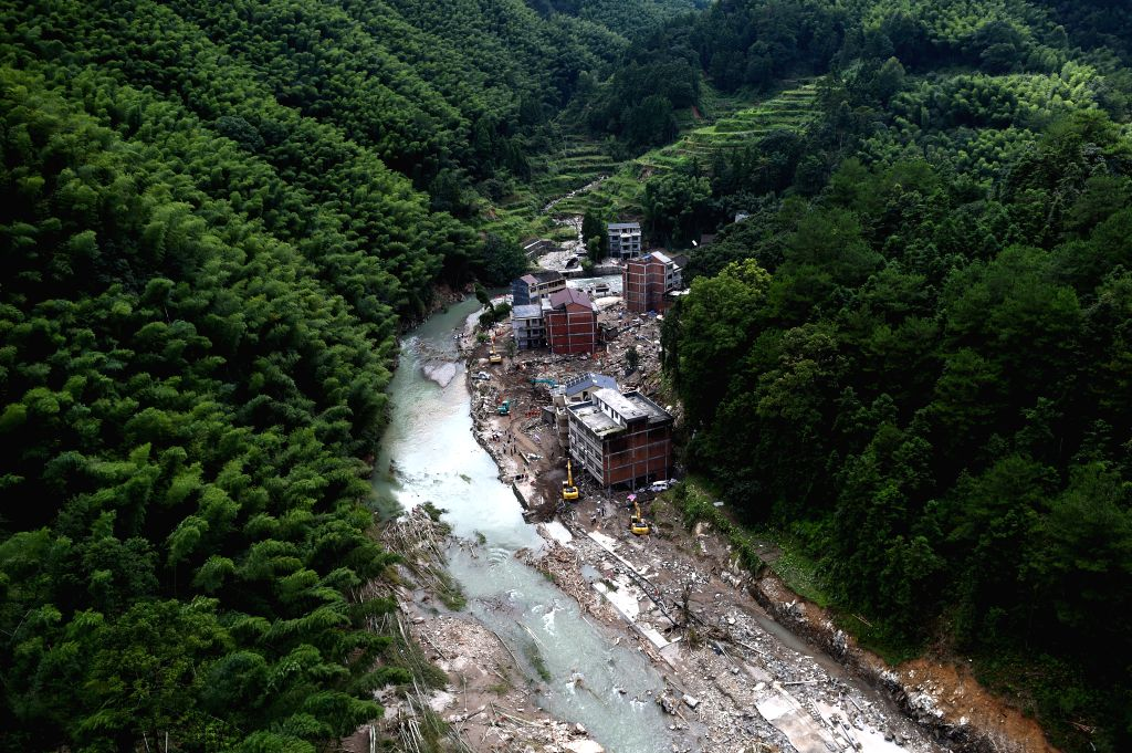 YONGJIA, Aug. 11, 2019 - Photo taken on Aug. 11, 2019 shows the site of the landslide in Shanzao Village of Yantan Township in Yongjia, east China's Zhejiang Province. A total of 32 people died and ...