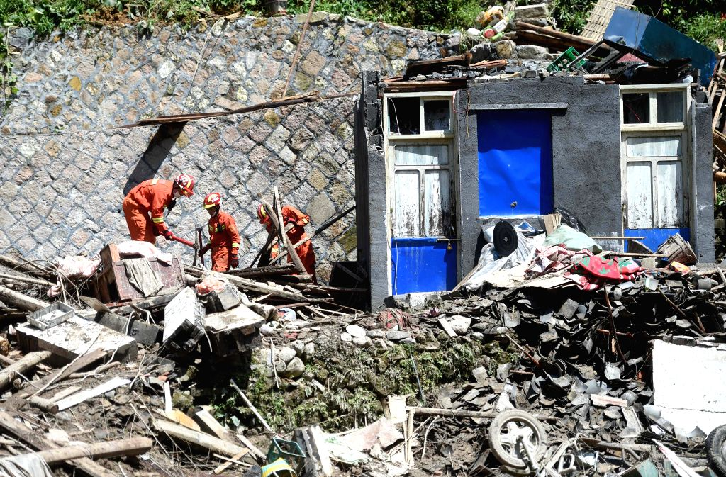 YONGJIA, Aug. 11, 2019 (Xinhua) -- Rescuers search for victims at the site of the landslide in Shanzao Village of Yantan Township in Yongjia, east China's Zhejiang Province, Aug. 11, 2019. A total of 32 people died and 16 remain missing after Lekima,