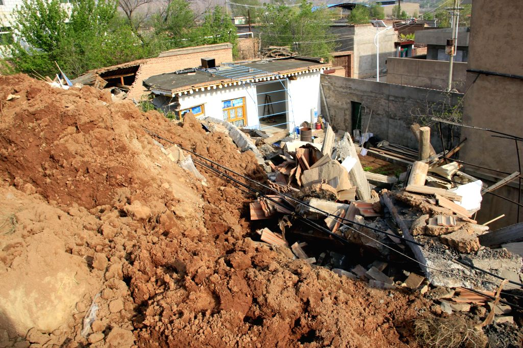 A damaged house is seen at the landslide site in Yongjing County, northwest China's Gansu Province, April 29, 2015. Two landslides occurred in Yanguoxia Township, ...