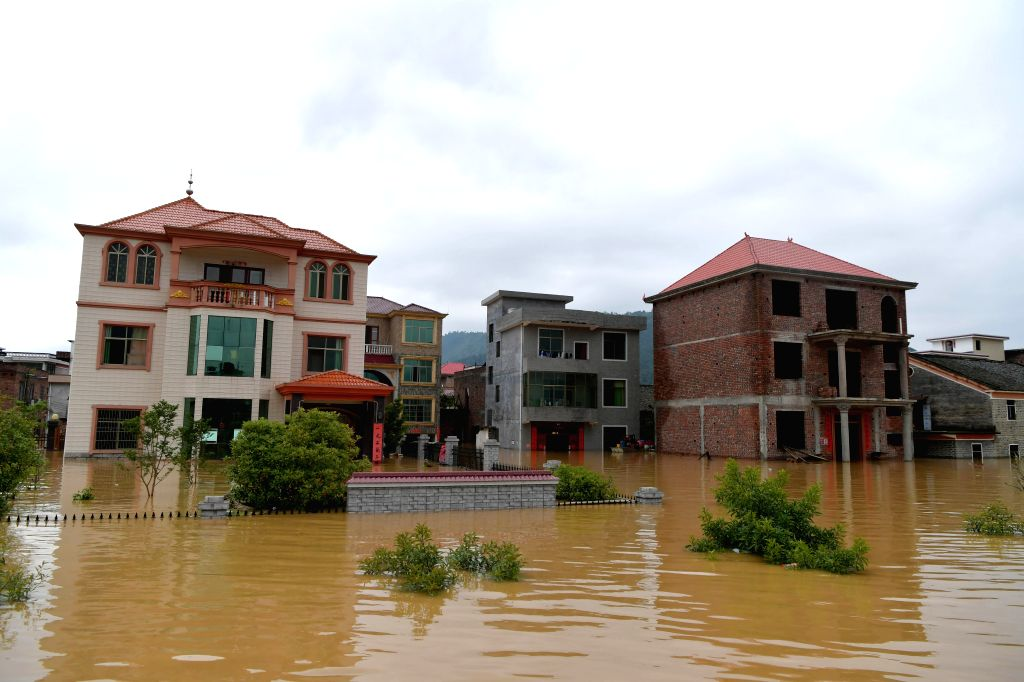 YONGXIN, June 9, 2019 (Xinhua) -- Photo shows the waterlogged Paixing Village of Zaizhong Township in Yongxin County, east China's Jiangxi Province, June 9, 2019. Heavy rainfall swept Jiangxi in the past two days. In Paixing, 116 stranded people have