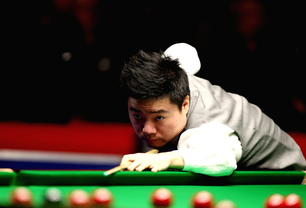 Ding Junhui of China competes during the Snooker UK Championship 2014 first round match against John Sutton of Ireland at the York Barbican Center in York, England, on November 26, 2014. Ding ..
