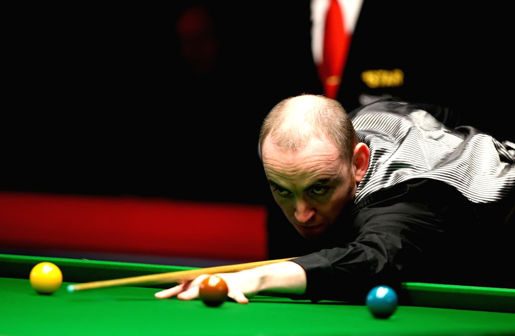 John Sutton of Ireland competes during the Snooker UK Championship 2014 first round match against Ding Junhui of China at the York Barbican Center in York, England, on November 26, 2014. Ding ..